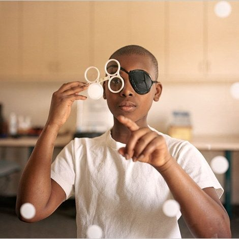 Brian Dennis at a vision therapy session in Bethesda, Md. Credit...Samantha Contis for The New York Times